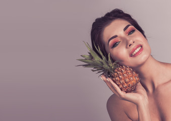 Woman with pineapple fruit