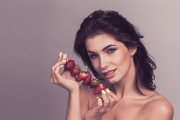 Woman with strawberry dessert