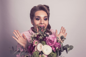 Woman surprised with bunch of flowers