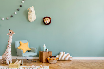 Stylish scandinavian kid room with toys, teddy bear, plush animal toys, mint armchair, umbrella, cotton balls. Modern interior with eucalyptus background walls, Design interior of childroom. Template