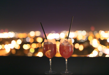 Two cocktails on open terrace.