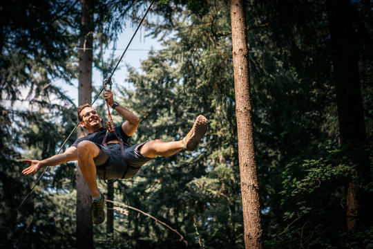 Smiling man on a zip line