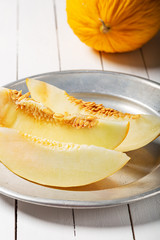 Sweet yellow fresh melon on wooden table