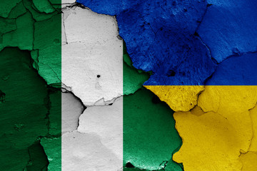 flags of Nigeria and Ukraine painted on cracked wall