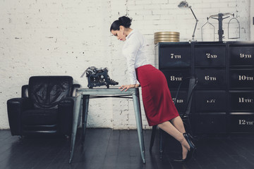 Secretary in the style of Hollywood retro films at the office