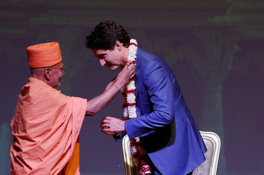 Liberal leader and Canadian Prime Minister Justin Trudeau is presented with a flower garland as he visits BAPS Shri Swaminarayan Mandir during an election campaign visit, in Etobicoke, Ontario