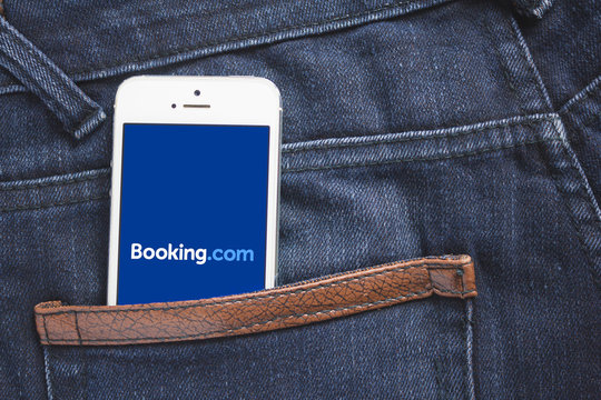 Bangkok, Thailand - October 13, 2019 : Booking.com logo on iPhone 6. Bookine.com is an online travel agency based that offers accommodation booking services through its website and mobile
