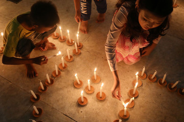 People light candles at a pagoda during the Thadingyut festival in Mandalay