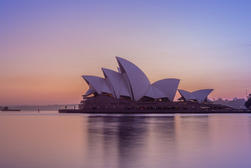 Sydney, Australia - January 6, 2019: sydney opera house at sunrise. This building is one of the 20th century's most famous and distinctive buildings.