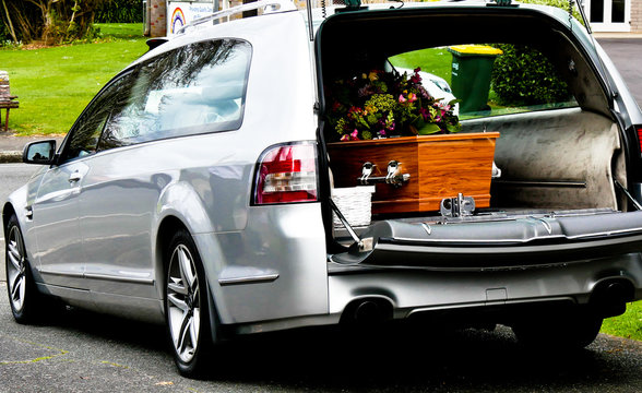 Shot of hearse arriving or leaving a funeral