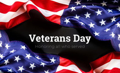 American flag on a black background. Veterans Day. honoring all who served. 11 november