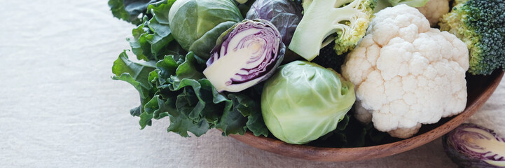 cruciferous vegetables in wooden bowl, reducing estrogen dominance, ketogenic diet, vegan plant based food