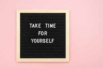 Take time for yourself. Motivational quote on letterboard on pink background. Top view Flat lay Copy space Concept inspirational quote of the day