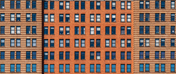 Banner and cover scene of Brown Brick high building facade with windows in New York City, United states of America, USA, Industrial Background and texture, Loft inspiration. Construction facade,