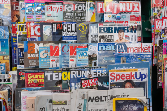 VENICE,ITALY,APRIL 5:  Magazines on a kiosk display in Venice Italy on April 5,2019