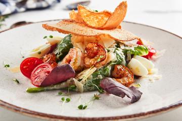 Spoed Foto op Canvas Klaar gerecht Beautiful serving white restaurant plate of caesar salad
