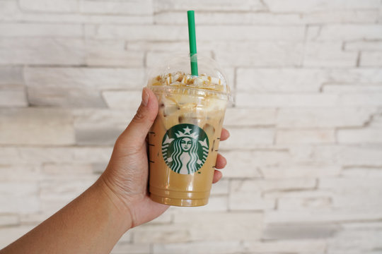 CHIANG MAI, THAILAND - JANUARY 21 2018:Hand Hold a Glass of Coffee from Starbucks Coffee Brand  in Chiang Mai  on January 21,2018