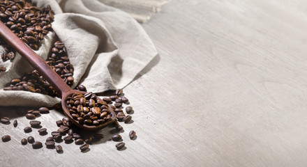Banner panoramic layout of fresh roast coffee espresso beans on wood table, artistic design, backdrop for advertisement with copy space