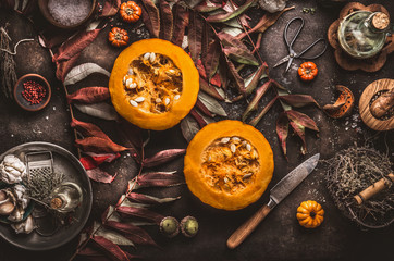 Autumn, seasonal ,food, background ,halved ,pumpkin, knife , herbs ,spices ,dark ,rustic ,background ,fall, leaves, Top view, Border