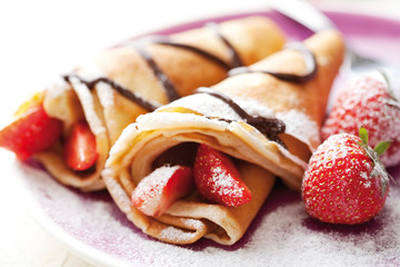pancakes with fresh strawberries and chocolate cream