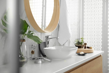Stylish bathroom interior with vessel sink and mirror