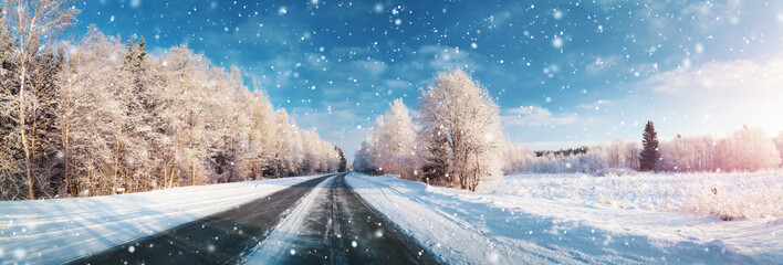 Wall Murals Blue jeans winter road, covered with snow on sunny day