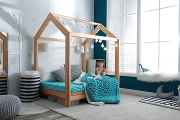 Cozy child room interior with comfortable bed