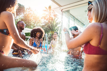 Group of multiracial friends having fun at pool party