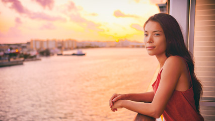 Wall Mural - Cruise ship vacation Asian woman relaxing on boat deck luxury getaway travel sunset Caribbean tropical winter destination.