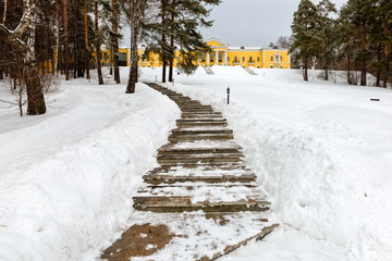 MOSCOW REGION, RUSSIA - MARCH 2, 2019: Country Hotel Bor on a winter day. Located on a hilltop in a coniferous forest on the banks of the river Rozhayka