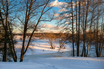 View from the shore on a frozen river on a winter day
