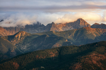 Wall Murals Pale violet Mountain peaks in clouds at sunset. Tatra Mountains, Poland