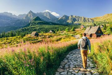 Fototapeta Man walking on hiking trail in Tatra mountains in Poland obraz