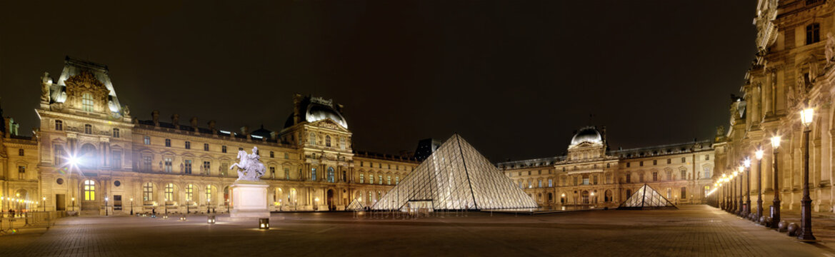 PARIS-APRIL 4: Panoramic view of Louvre Art Museum at night. The Louvre is the biggest Museum in Paris displayed over 60,000 square meters of exhibition space, on April 4, 2013 in Paris, France.