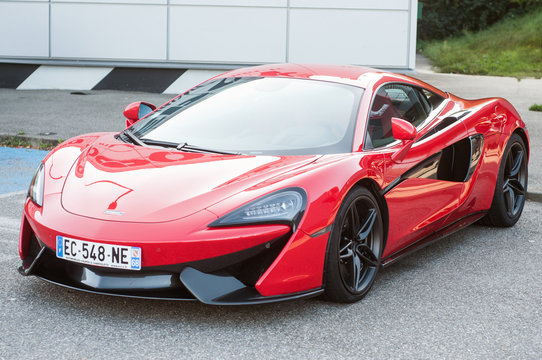 Mulhouse - France - 13 October 2019 - Front view of red Mc laren super car parked in the street
