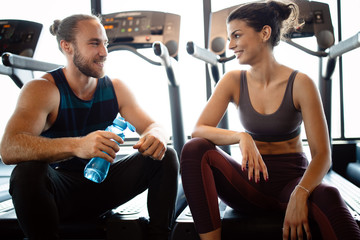 Happy fit friends exercising, working out in gym to stay healthy together Fototapete