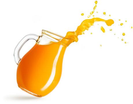 flying pitcher spilling orange juice isolated on white