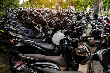 Scooter Motorcycles group parking on city street during adventure journey.