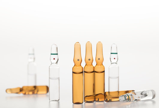 Glass medicine ampoules on a white background
