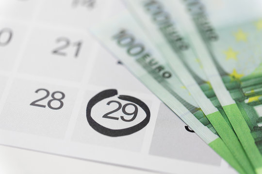 shopping, sale and marketing concept - close up of black friday date on calendar and money