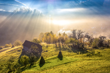 Canvas Prints Honey Beautiful scenery landscape Romania village mountains hills fields foggy morning first ray splitting light