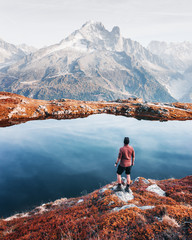 Amazing view on Monte Bianco mountains range with tourist on a foreground. Lac de Cheserys lake, Chamonix, Graian Alps. Landscape photography