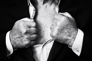 Elderly man tearing a shirt and a suit on his chest showing hairy bare torso