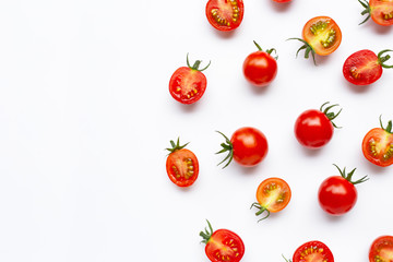 Fresh tomatoes, whole and half cut isolated on white background.