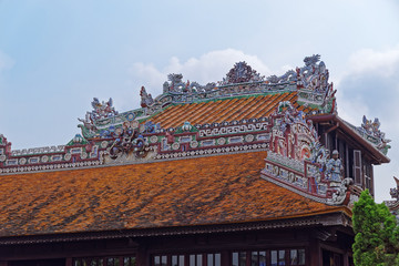 Colorful ornate building roof in Purple Forbidden city (Imperial Citadel) in Hue, Vietnam