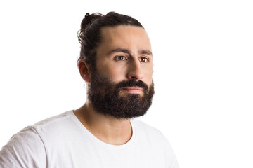 portrait of bearded man looking away with thoughtful expression. Isolated on white background.