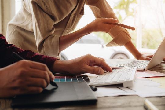 Web designer meeting  planning application for mobile phone. Design Online Technology Content, Ideas Proposal Strategy Tactics Vision Design Concept