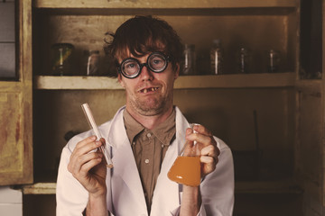Crazy scientist mixing potions in laborator