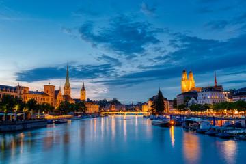 Zurich downtown skyline with Fraumunster and Grossmunster churches at lake zurich at night, Switzerland.