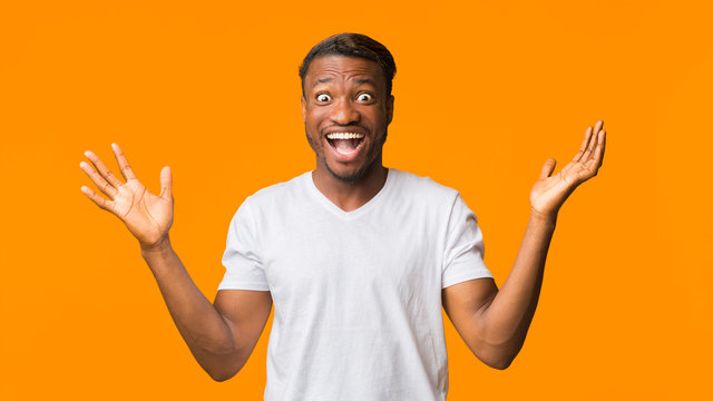 Surprised African American Man Shouting Looking At Camera, Studio, Panorama
